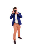 Male photographer with his camera isolated on white background Stock Photos