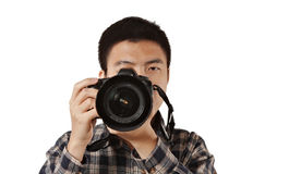 Male photographer holding camera. On white Stock Images