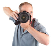 Male Photographer Shooting You. A male photographer is shooting you isolated on white Stock Photography