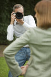 Male photographer takes a picture from model Royalty Free Stock Photography