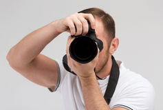 Male photographer taking picture with camera Stock Image