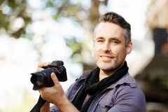 Male photographer taking picture Royalty Free Stock Photography