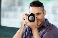 Male photographer taking picture Royalty Free Stock Photo