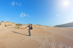 Male photographer travels the dunes. Royalty Free Stock Photography