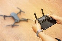 The male photographer is using a drone control device stock photos
