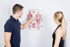 Male physio therapist and woman helping patient Royalty Free Stock Images