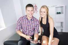 Male physio therapist and woman helping patient Stock Images