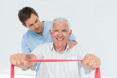 Male physiotherapist massaging senior mans back Royalty Free Stock Image