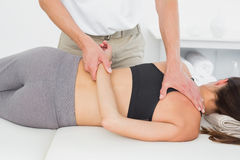 Male physiotherapist massaging womans body Royalty Free Stock Images