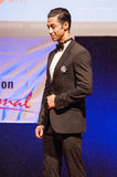 Male physique model shows his best in suit on stage Stock Image