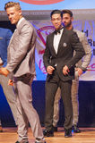 Male physique model shows his best in suit on stage Royalty Free Stock Photography