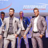 Male physique models show their best in suit on stage Royalty Free Stock Images
