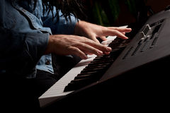 Male Pianist Performs on the Piano Keyboard Royalty Free Stock Photography