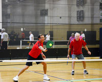 Male Pickleball Players in Action Stock Photo