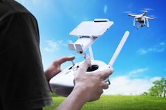 Male pilot controlling drone. With remote control Royalty Free Stock Image