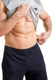 Male Pinching Fat From his Waist. Male athlete pinching fat from his waist, isolated in white Royalty Free Stock Images