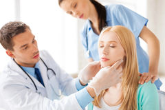 Male plastic surgeon with patient Royalty Free Stock Photos