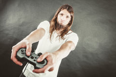 Male player focus on play games Stock Image