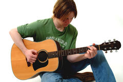 Male Playing Acoustic Guitar. Against white background Stock Images