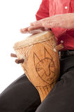 Male playing African drum on his lap Royalty Free Stock Images