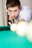 Male playing billiard at gambling club Royalty Free Stock Photos