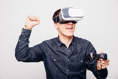 Male playing video games with virtual reality headset and joystick or dr Royalty Free Stock Photography