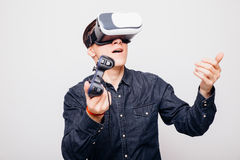 Male playing video games with virtual reality headset and joystick or driving with remote Royalty Free Stock Image