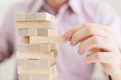 Male playing with wooden blocks Royalty Free Stock Photo