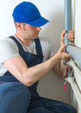 Male plumber. Male plumber assembling water pipes Stock Image