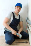 Male plumber. Male plumber assembling water pipes Royalty Free Stock Photos