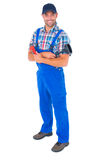 Male plumber holding plunger and wrench Royalty Free Stock Photo