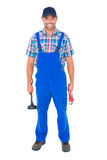 Male plumber holding plunger and wrench. Full length portrait of male plumber holding plunger and wrench on white background Stock Photo