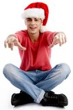 Male pointing at camera and wearing christmas hat. On an isolated background Royalty Free Stock Photo