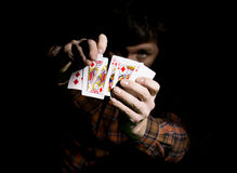 Male poker player holds five cards, winning combination. on a dark background.  Stock Photos