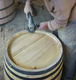 Male polish wood wine barrel. Barrel building. Royalty Free Stock Images
