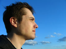 Male portrait. The Man on background sky Stock Image