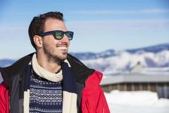 Male portrait on blue sky background on winter Royalty Free Stock Photo