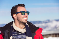 Male portrait on blue sky background on winter Stock Photos