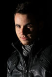 Male Portrait in the dark Stock Photography