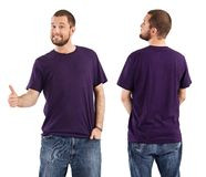 Male posing with blank purple shirt. Young male with blank purple t-shirt, front and back. Ready for your design or artwork Stock Photos