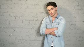 Male posing in a denim and a white T-shirt stock video footage
