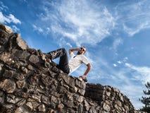 Male Posing on Stone Wall Stock Photo