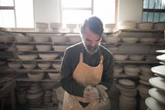 Male potter molding a clay. In pottery workshop Stock Photo