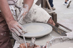 A male potter prepares his pottery wheel Royalty Free Stock Photos