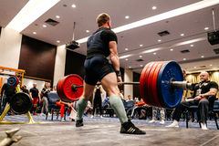 male powerlifter attempt a deadlift in sports gym stock photography