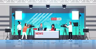 Free Male Presenter Interviewing Woman In Television Studio Tv Live News Show Video Camera Shooting Crew Broadcasting Concept Stock Photo - 159757390