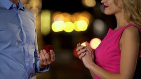 Male presenting beautiful girlfriend box with expensive jewelry, celebration. Stock photo royalty free stock photos