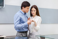 Male presents engagement ring to his girl Stock Image