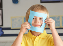 Male Primary School Cutting Out Paper Shapes Stock Photos