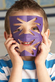 Male Primary School Pupil Cutting Out Paper Shapes Royalty Free Stock Image